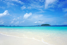 Beautiful White Beach, Blue Clear Sea Water, Sky, And Wave Foam