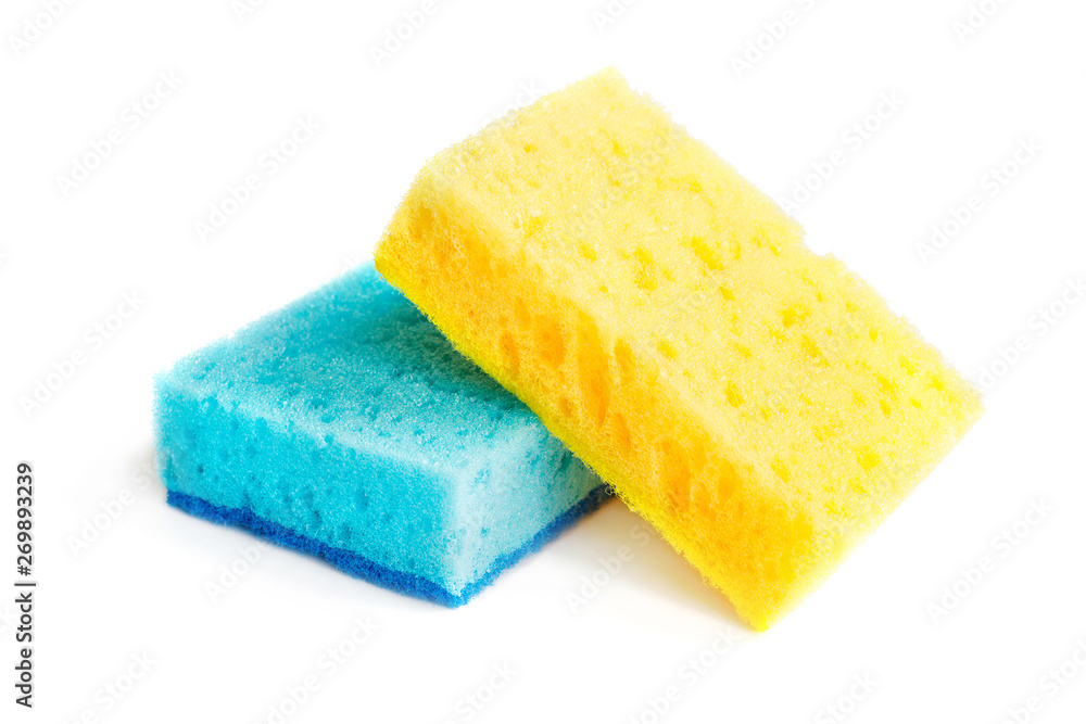 Fototapeta Colored sponges for washing dishes and other domestic needs. Yellow sponge lies on blue sponge at a slight angle. Isolate