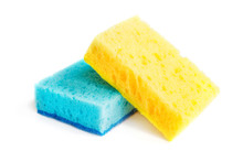 Colored Sponges For Washing Dishes And Other Domestic Needs. Yellow Sponge Lies On Blue Sponge At A Slight Angle. Isolate