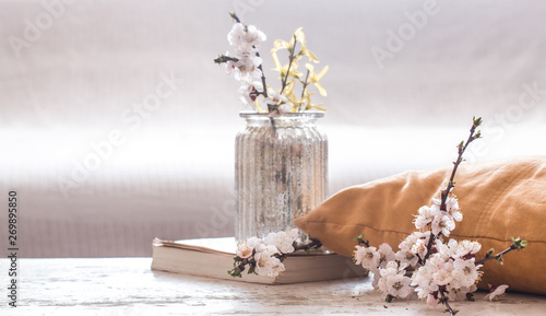 Leinwand Poster Home decor in the living room on a wooden background with spring flowers