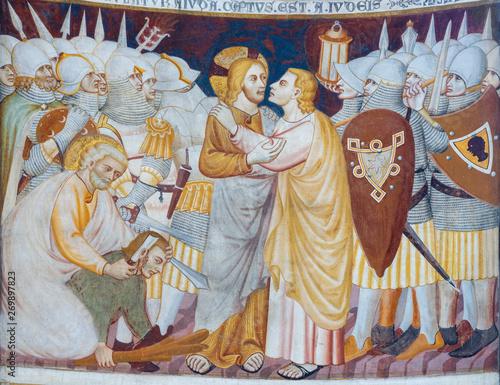 Fotografija COMO, ITALY - MAY 9, 2015: The old fresco of Betray of Jesus with the Judas kiss in church Basilica di San Abbondio by unknown artist Maestro di Sant'Abbondio (1315 - 1324)
