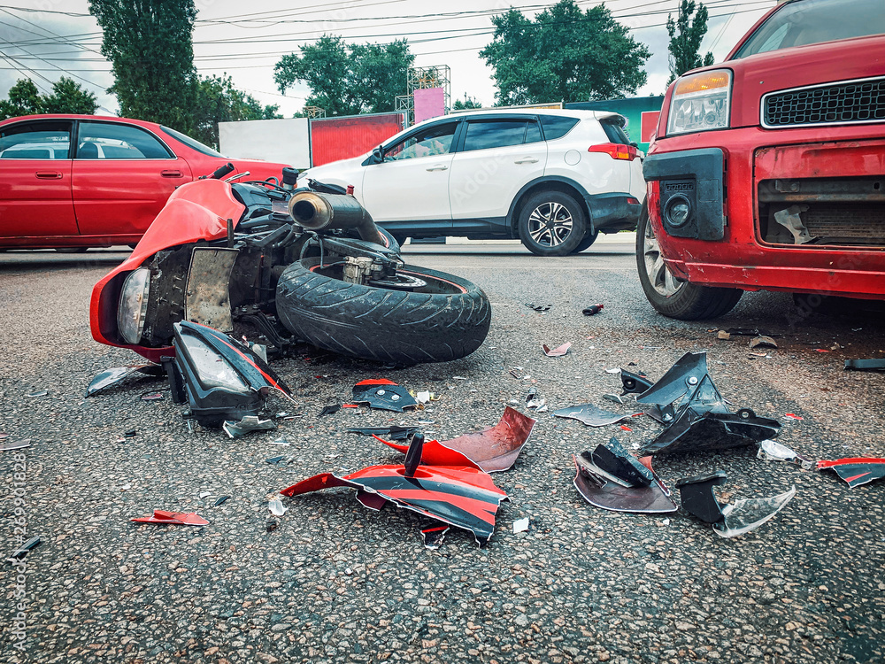 Fototapeta Motorcycle bike accident and car crash, broken and wrecked moto on road