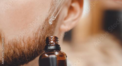 Fotografija Oil for care and growth of beard, barbershop