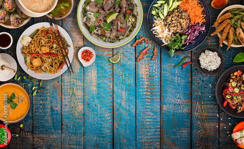 Foto Asian food background with various ingredients on rustic wooden table , top view