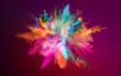 Leinwandbild Motiv Colored powder explosion on dark gradient background. Freeze motion.