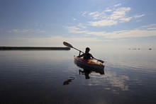 Kayaker Enjoying A Very Calm Early Morning Paddle On Biscayne Bay In Biscayne National Park, Florida