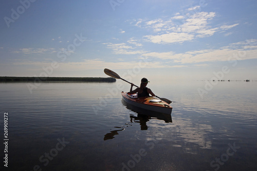 Kayaker enjoying a very calm early morning paddle on Biscayne Bay in Biscayne Na Wallpaper Mural