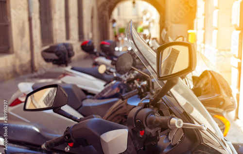 Motobikes parked in narrow street
