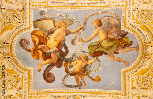 Valokuvatapetti OSSUCCIO, ITALY - MAY 8, 2015: The baroque fresco of angels with the mariological inscriptions in church Sacro Monte della Beata Vergine del Soccorso by Salvatore Pozzi di Puria  (1595 – 1681)
