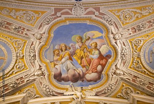 OSSUCCIO, ITALY - MAY 8, 2015: The baroque fresco choir of angels with the music instruments in church Sacro Monte della Beata Vergine del Soccorso by Salvatore Pozzi di Puria  (1595 – 1681) Canvas-taulu