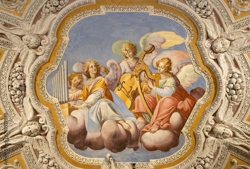 Valokuva  OSSUCCIO, ITALY - MAY 8, 2015: The baroque fresco choir of angels with the music instruments in church Sacro Monte della Beata Vergine del Soccorso by Salvatore Pozzi di Puria  (1595 – 1681)