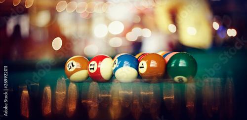 Foto Colorful billiard balls on a billiard table.