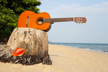 Guitar On Sand Beach In The Be...