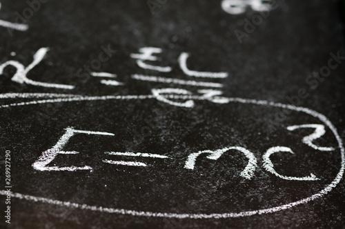 Mathematical derivation of E=mc^2 on a blackboard Tablou Canvas