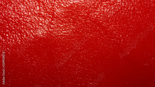 The texture of tomato paste.Ketchup background.Tomato sauce. Wallpaper Mural