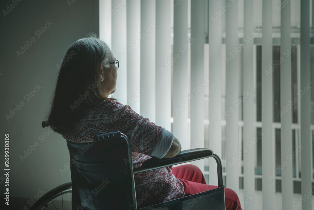 Fototapety, obrazy: Rear view of aged woman looking out the window
