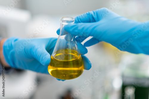 The scientist test the natural product extract, oil and biofuel solution, in the chemistry laboratory Tableau sur Toile