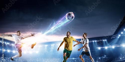 Fotografia, Obraz  Soccer players on stadium in action. Mixed media