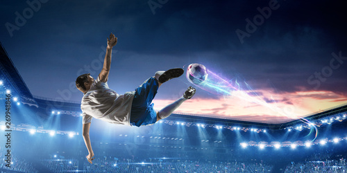 Fotografia Soccer player on stadium in action. Mixed media