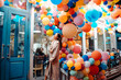 Leinwanddruck Bild - Woman on the background of wooden door with balloons