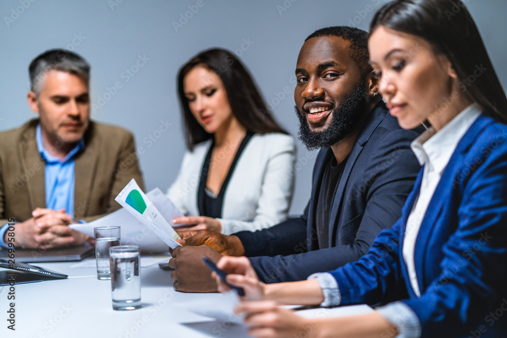 Fototapety, obrazy: The four business people discussing at the table