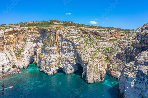 Foto auf AluDibond Rosa dunkel Blue Grotto in Malta, aerial view from the Mediterranean Sea to the island.