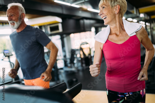 Fotografia, Obraz  Picture of senior people running on treadmill in gym