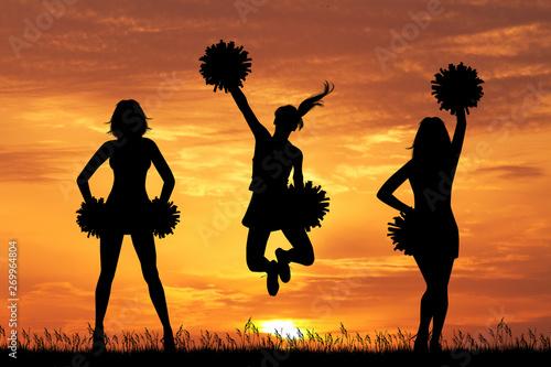 Cuadros en Lienzo illustration of cheerleader silhouette at sunset