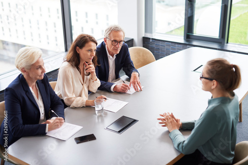 Valokuva  Woman during job interview and three elegant members of management