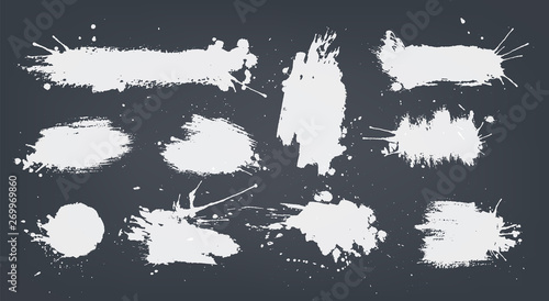 Fotografia set white ink spots set on black background.