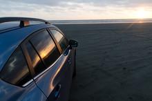 Blue Hatchback Under Sunset  L...