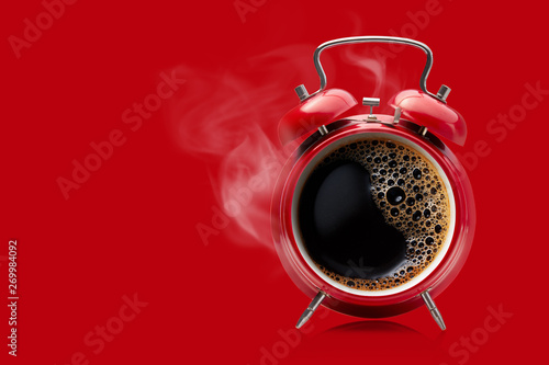 Obraz na plátne Red alarm clock with hot black coffee.