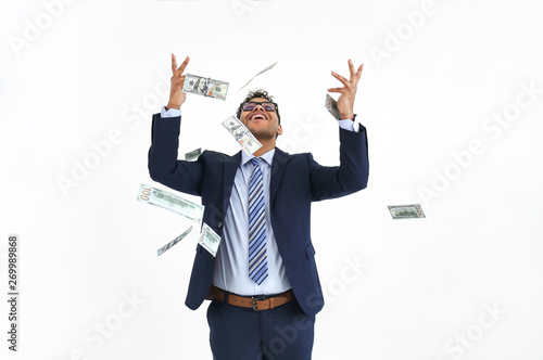 Fotografie, Obraz  Happy businessman and falling dollar banknotes on white background