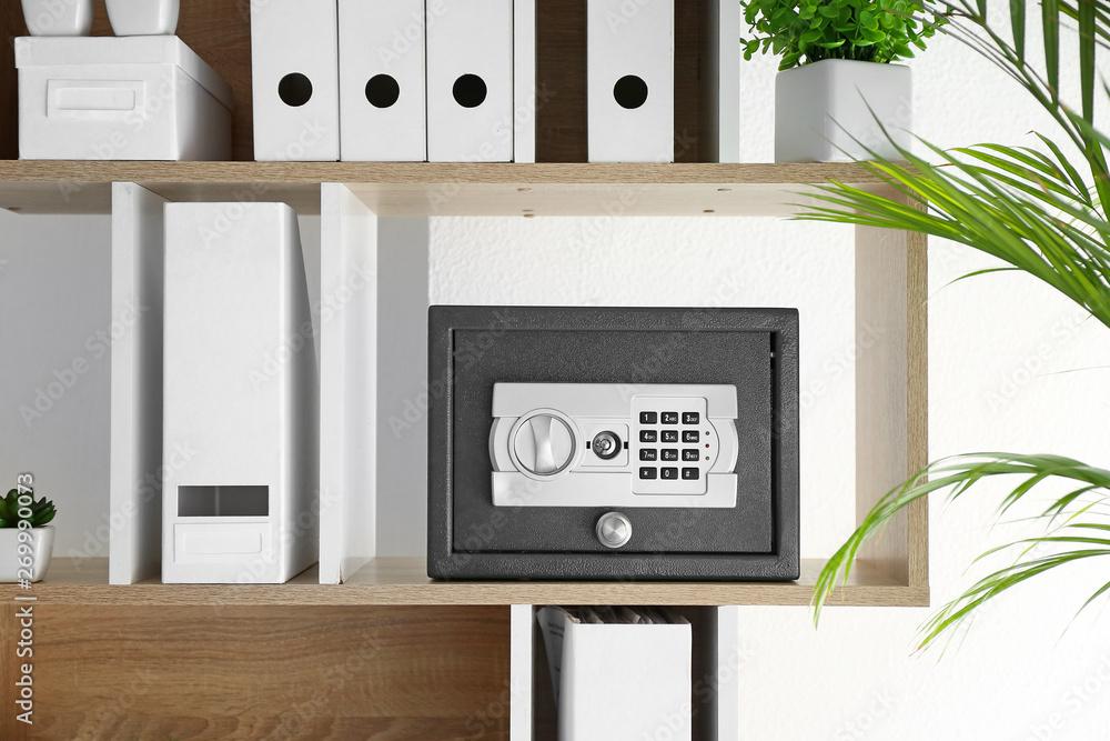 Fototapeta Modern safe on shelf in office