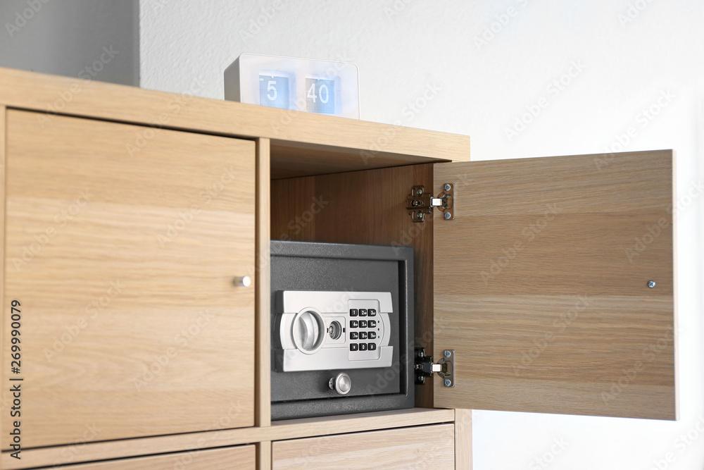 Fototapeta Modern small safe in cabinet