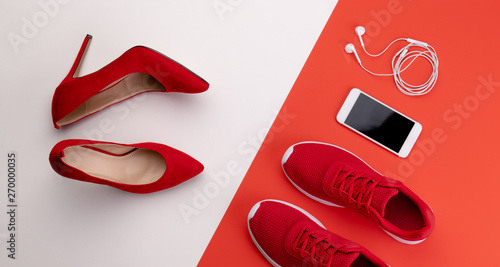 Fotografia  A studio shot of pair of running vs high heel shoes on color background