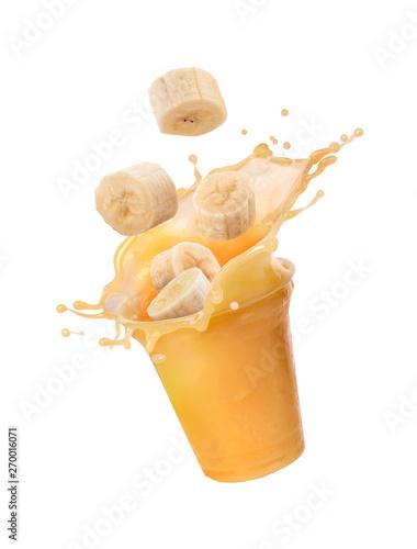 banana juice with a splash and bananas