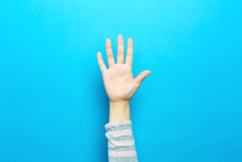 Person Raising Their Hand Up O...