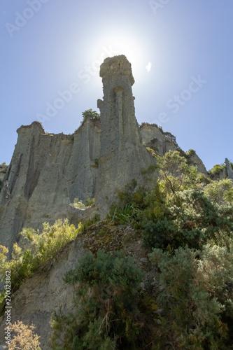 looking up at the puntangirua pinnacles with the behind a pinnacle Wallpaper Mural