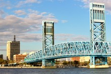 Jacksonville Bridge On A Bright Sunshine Day With Blue Sky And Puffy White Clouds.