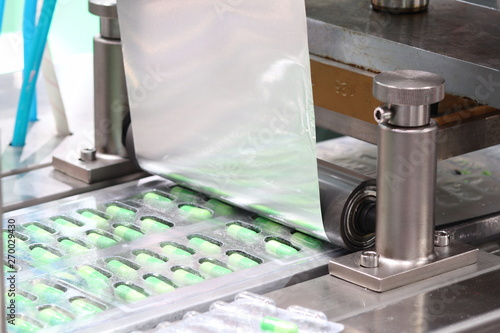 Slika na platnu medicine capsules packing machine ;  production process ;health industry backgro