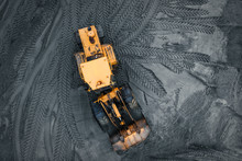 Yellow Excavator Or Bulldozer In Coal Open Cast Mining Quarry, Industrial Extraction Of Minerals, Aerial Top View