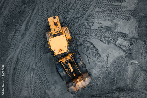 Canvastavla Yellow excavator or bulldozer in coal open cast mining quarry, industrial extrac
