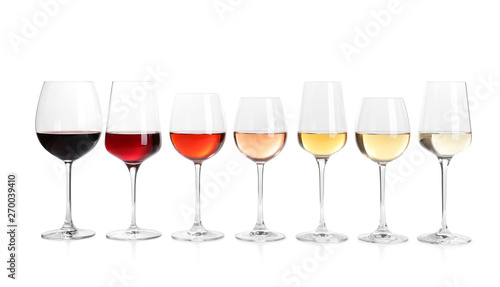 Poster de jardin Alcool Row of glasses with different wines on white background
