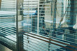 modern office interior background, glass window wall with jalousie blinds