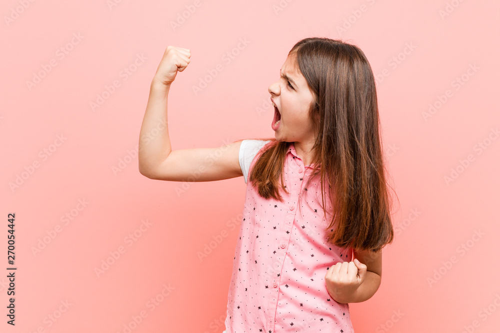 Fototapety, obrazy: Cute little girl raising fist after a victory, winner concept.