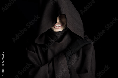 Fotografie, Tablou smiling woman in death costume isolated on black