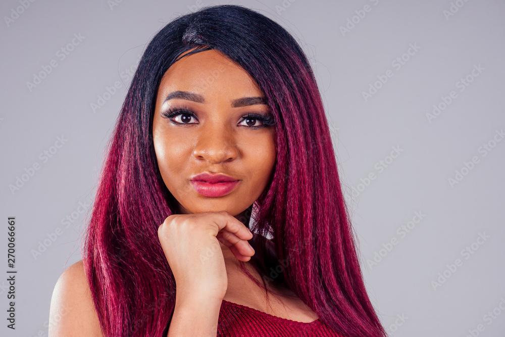 Fototapeta african american beautiful woman creative hair coloring dye purple color on white background in studio