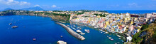 Beautiful Island Town In Italy. Panoramic Aerial View Overlooking The Harbor And Pastel Buildings Of Procida.