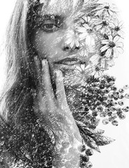 Fototapeta Do Spa Paintography. Double Exposure portrait of a beautiful young woman gently touching her face combined with hand drawn painting with floral motifs. black and white